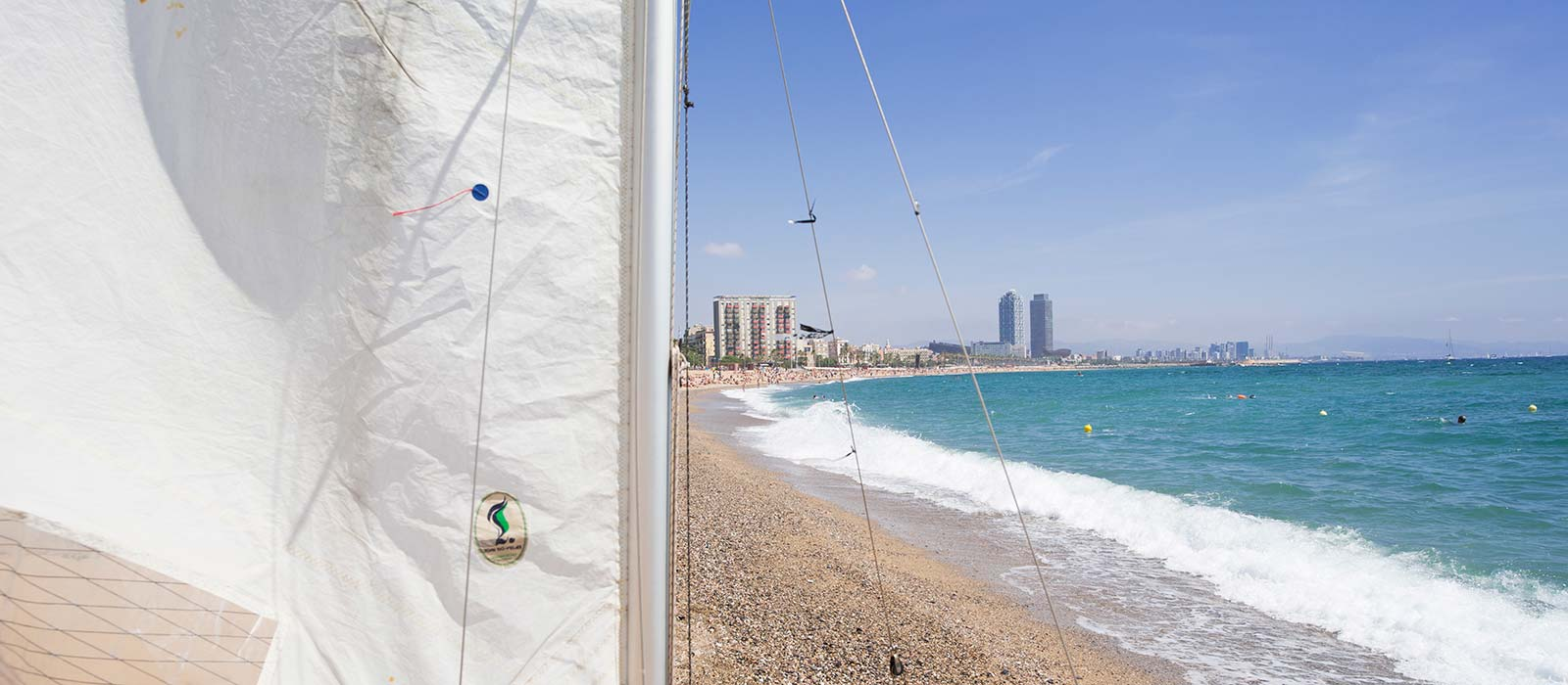 Barceloneta beach sailing boat