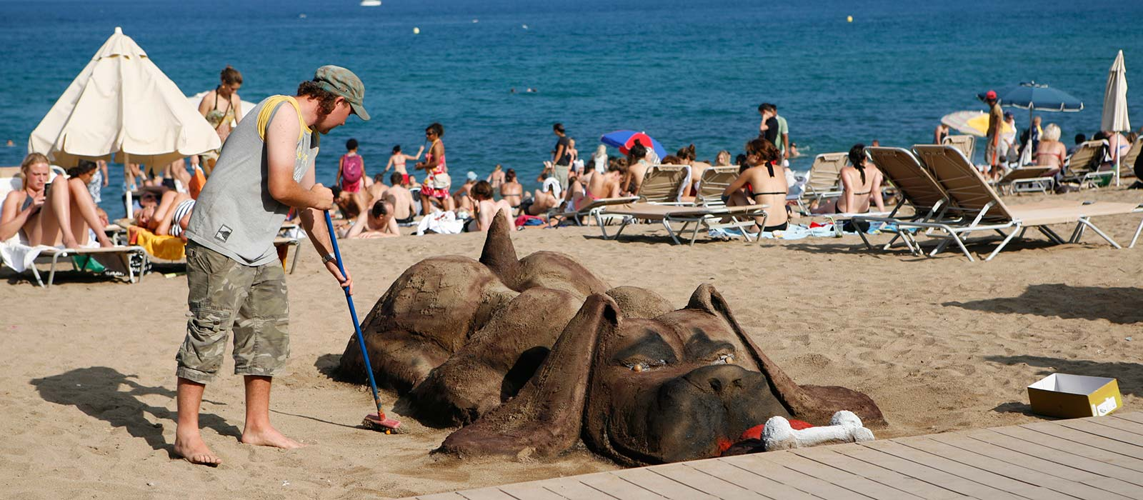 Barcelona beach sculpture of dog in sand