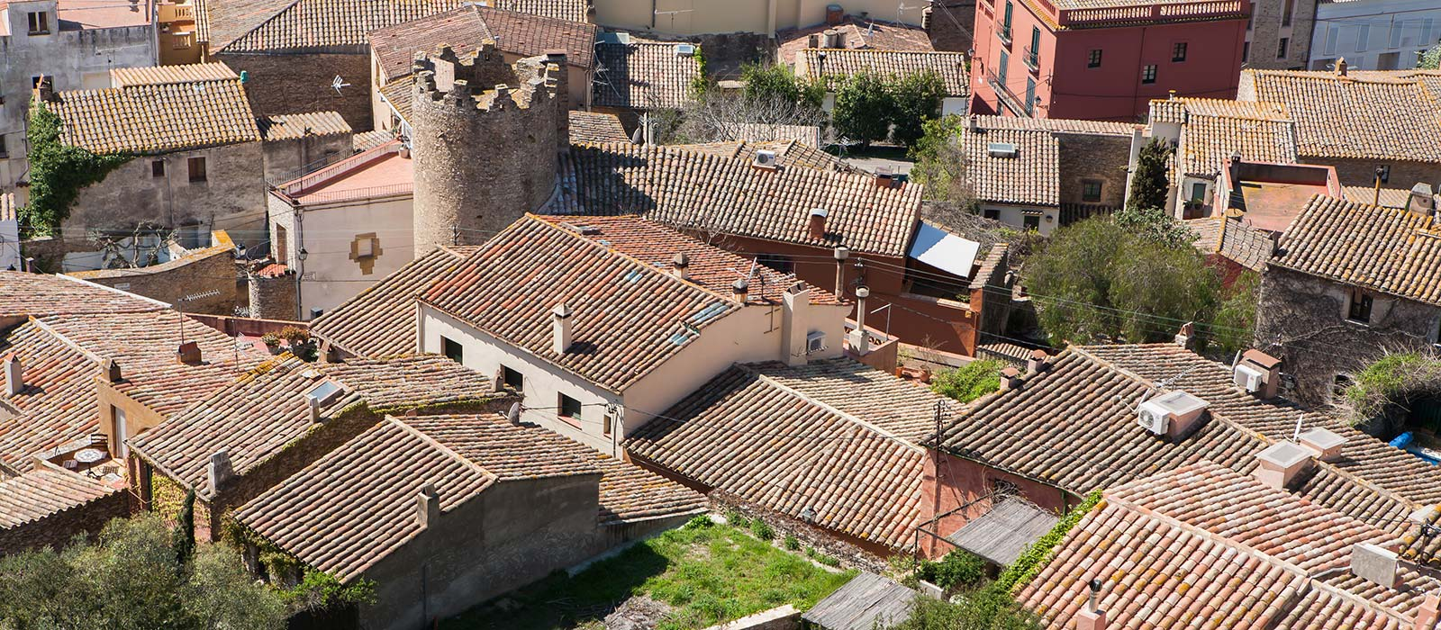 Costa Brava Begur, houses with red tiles and defensetower